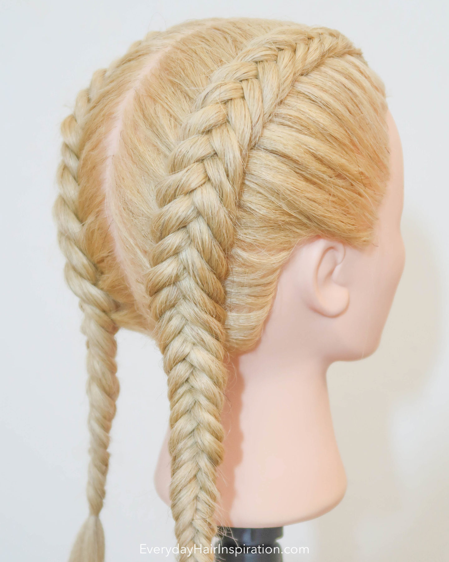 Hairdresser doll, with 2 dutch fishtail braids, one on each side.