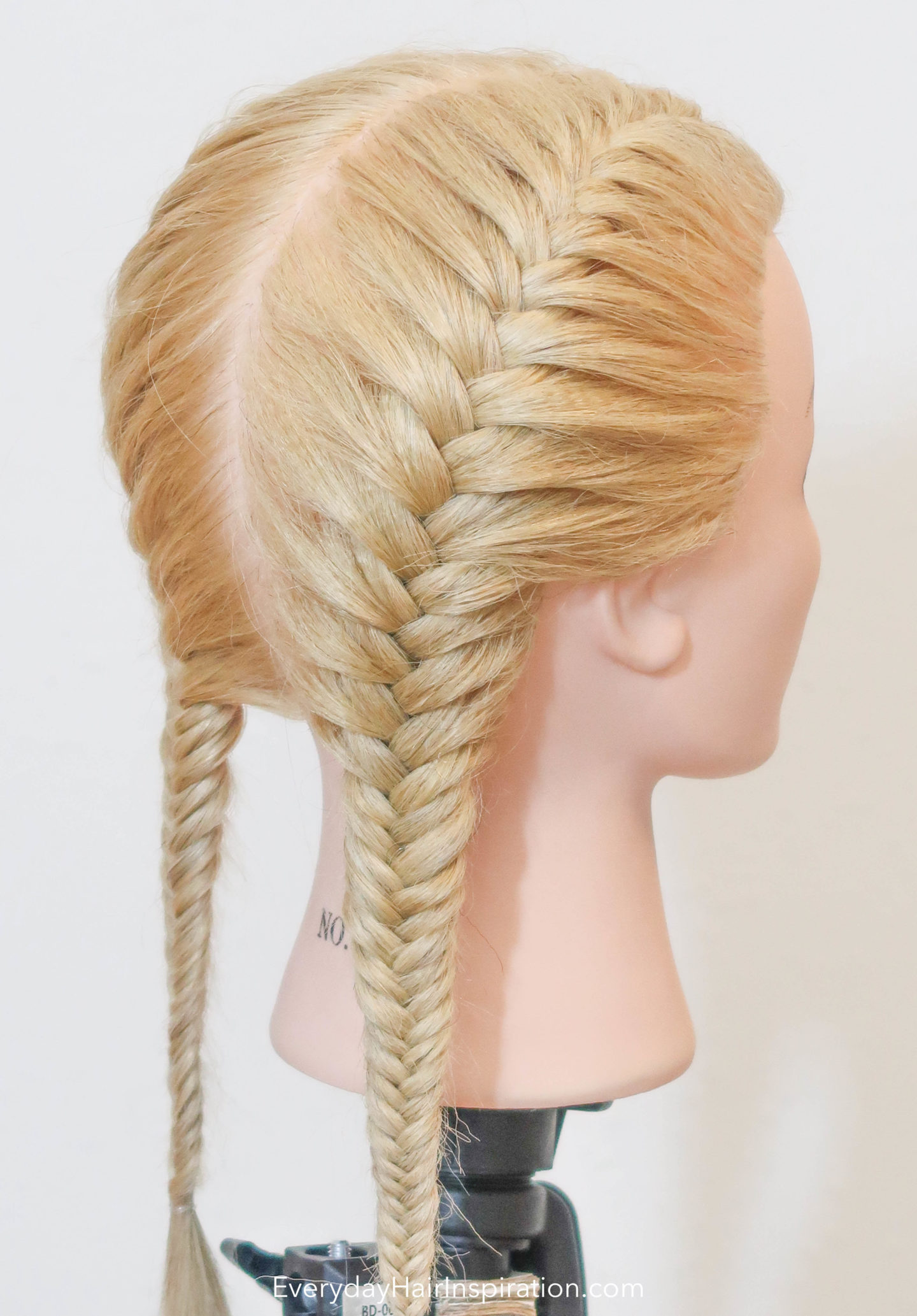 Blonde hairdresser doll with double french fishtails