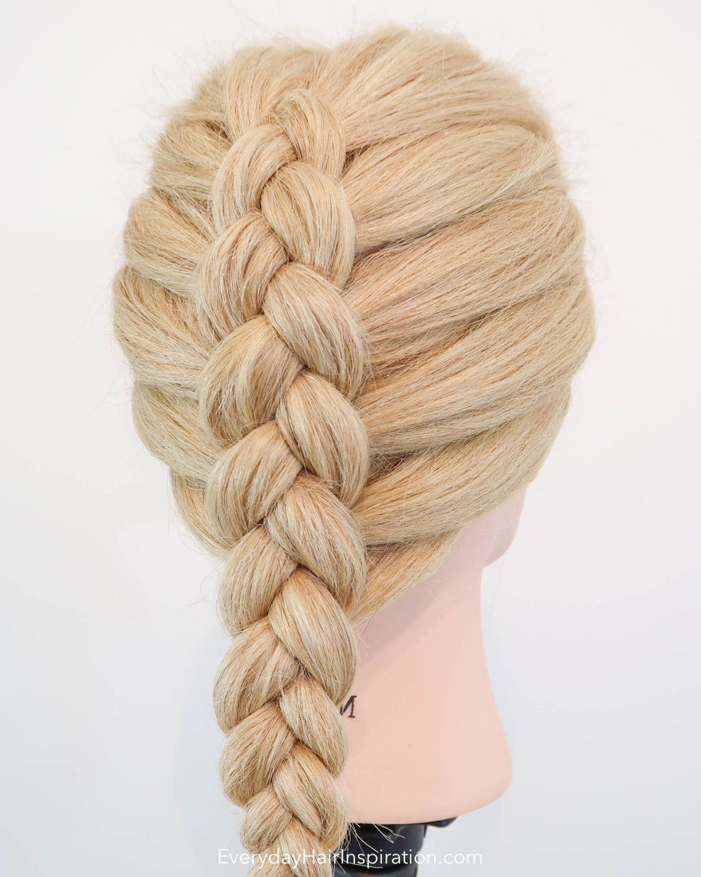 Blonde hairdresser doll with a single dutch braid down the back of the head