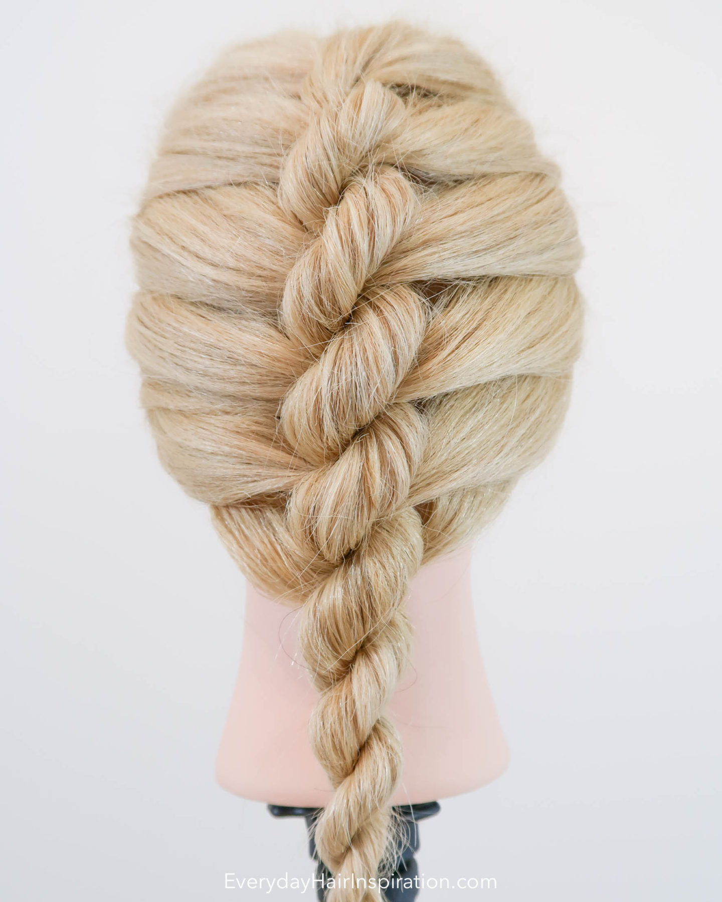 Blonde hairdresser doll with a single french rope braid in the hair - Looking at the braid straight on from the back