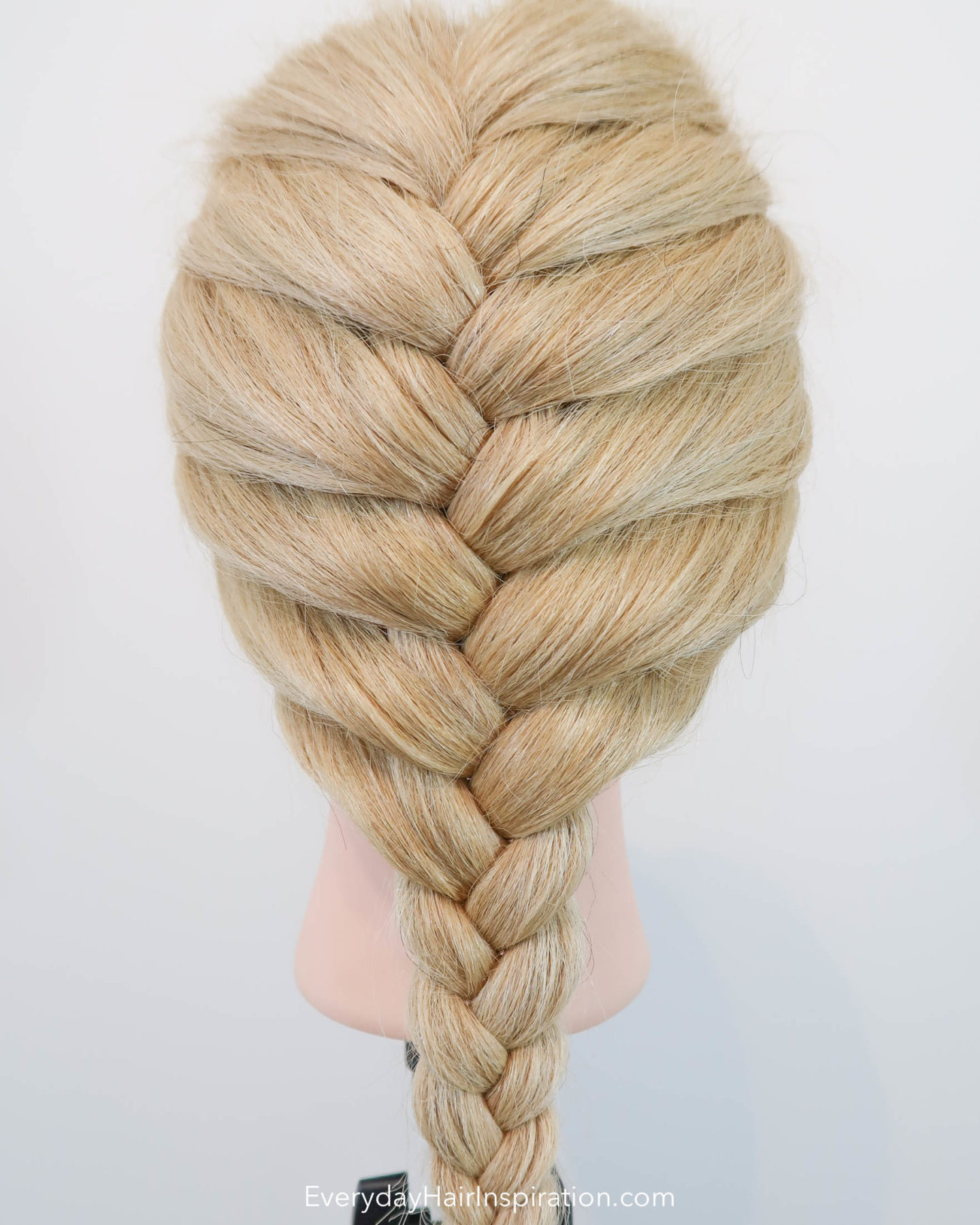 Blonde hairdresser doll with a single French braid