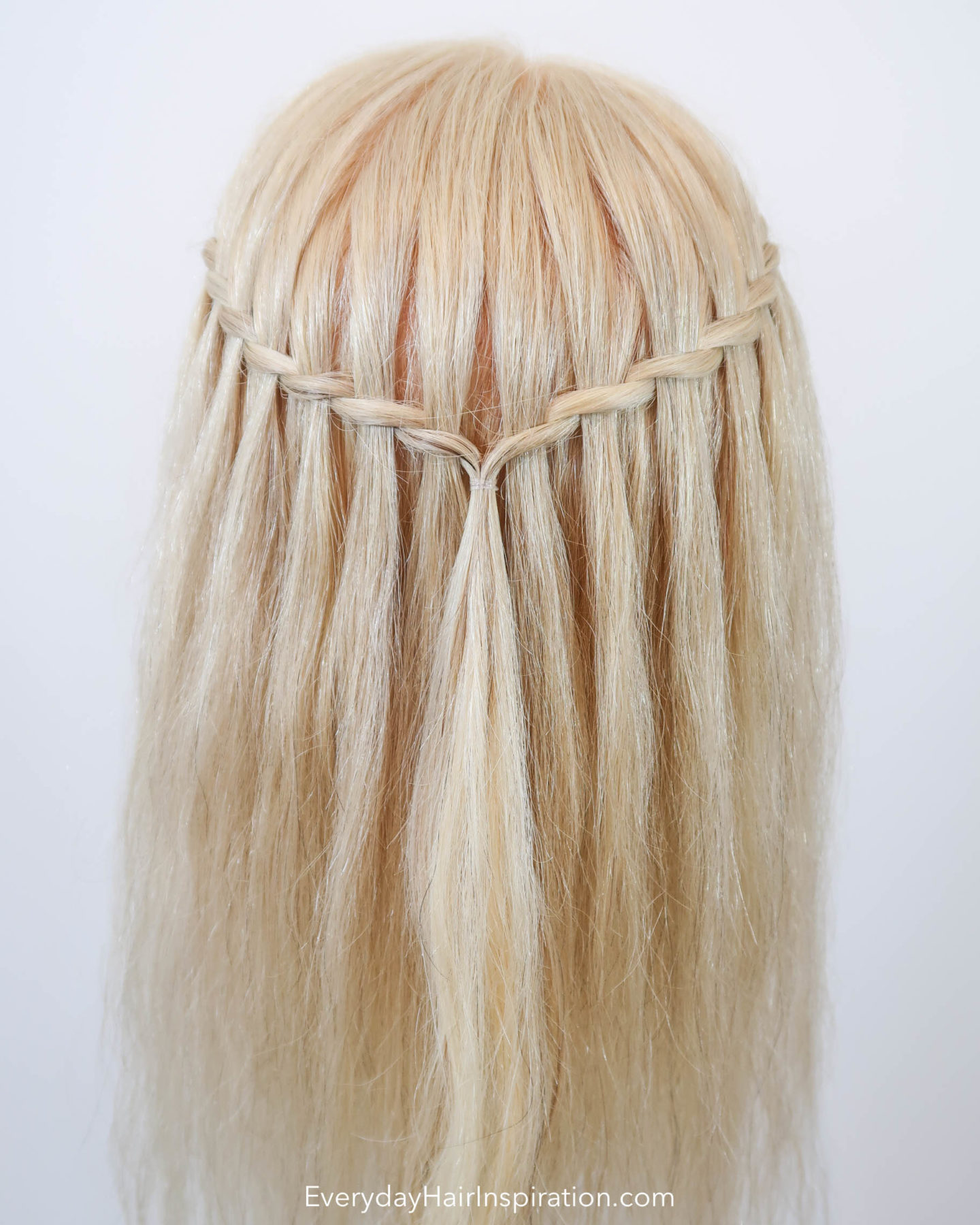 Blonde Hairdresser doll with a twisted waterfall braid in the hair, seen from the back.