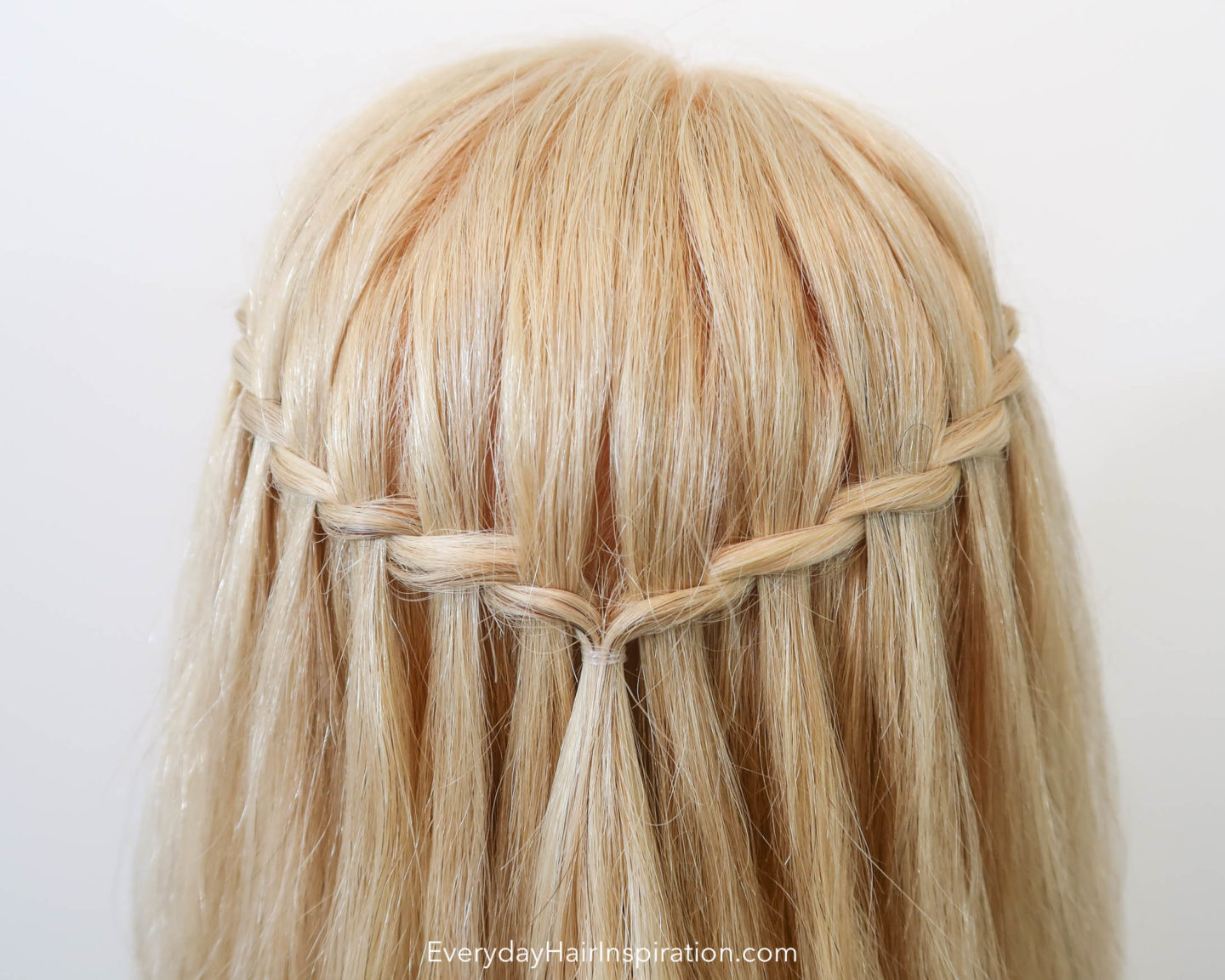 Blonde Hairdresser doll with a twisted waterfall braid in the hair, closeup seen from the back