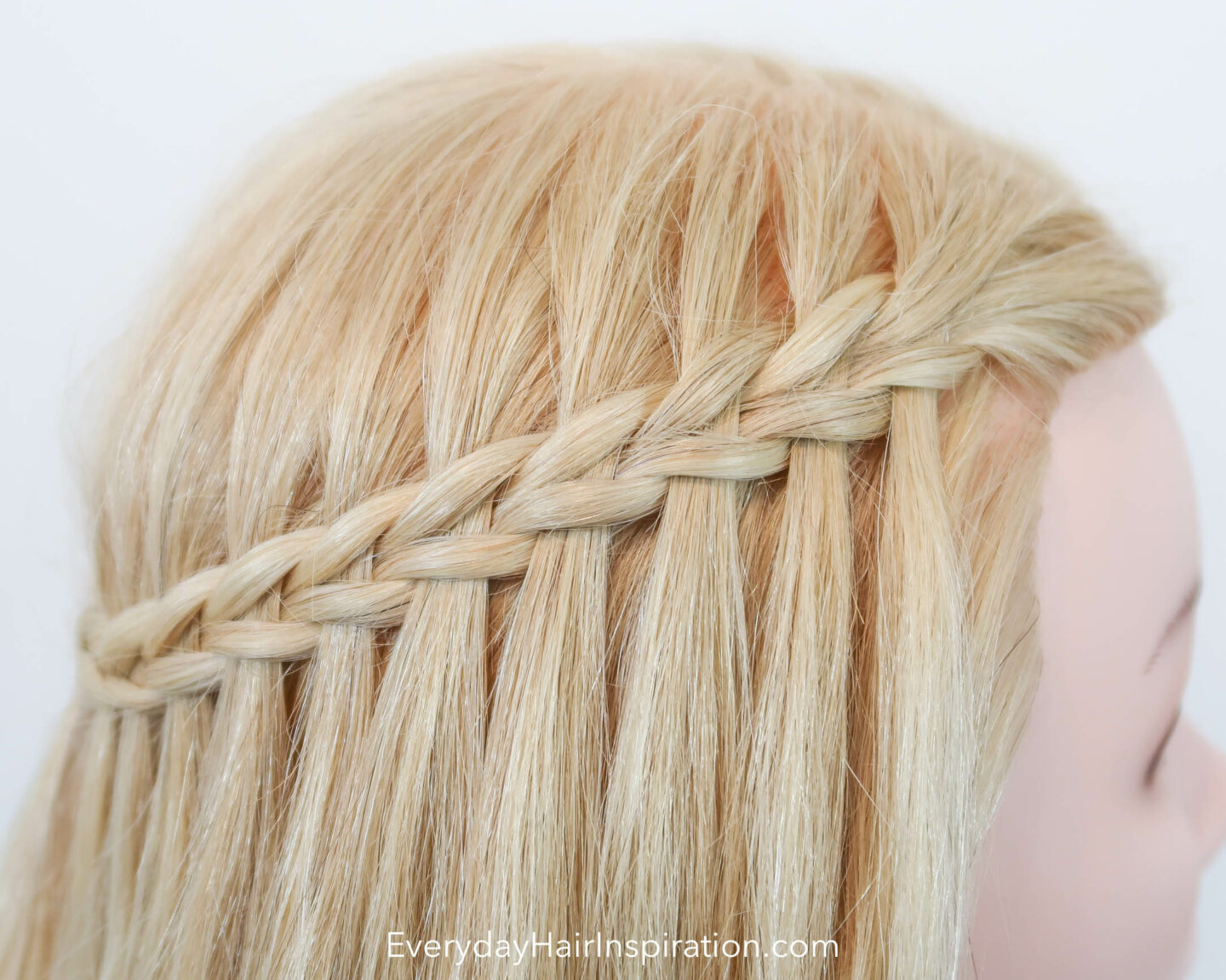 Close up of blonde hair with a scissor water fall braid.