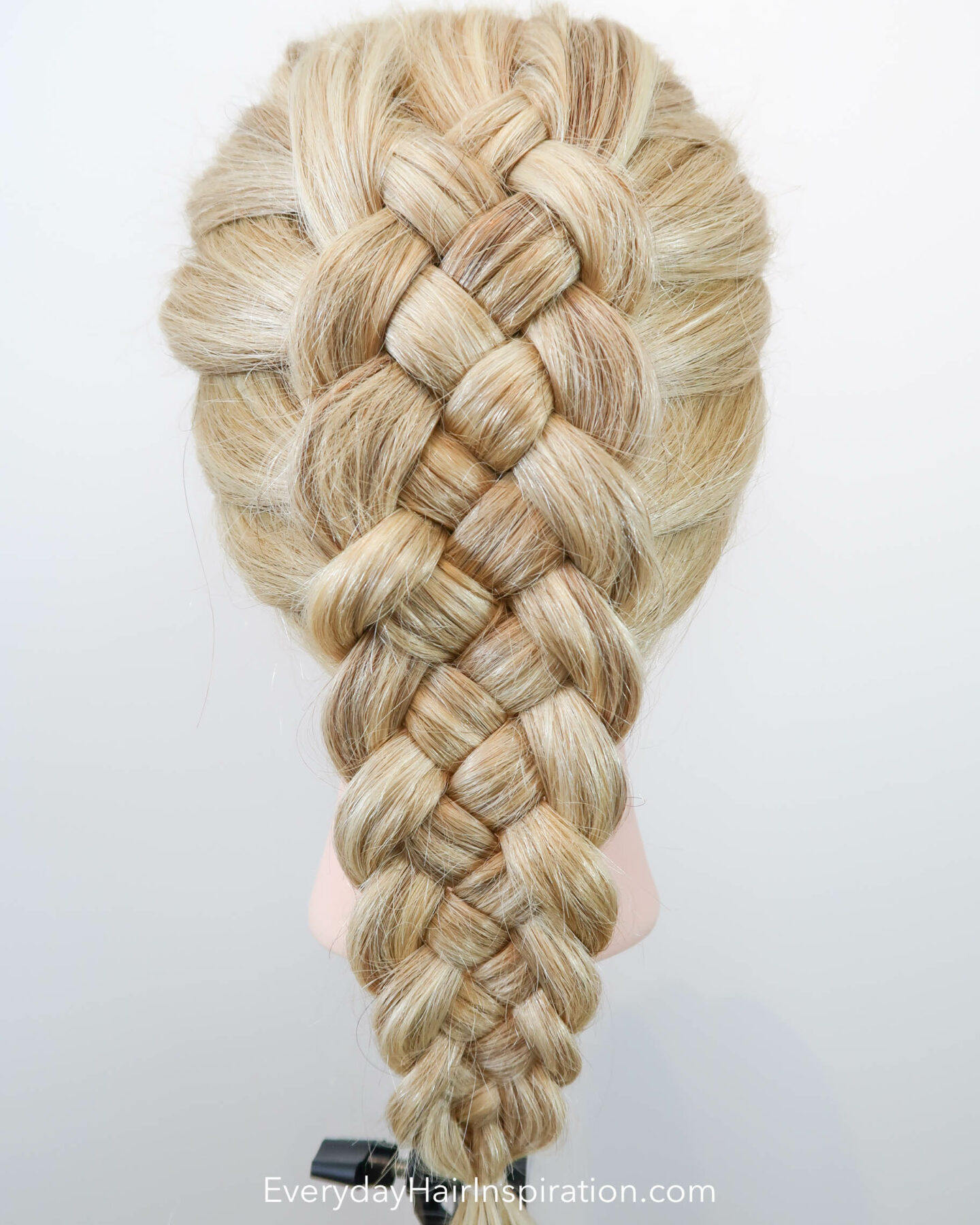 Blonde hairdresser doll with the hair styled into a dutch 5 strand braid, seen from the back.