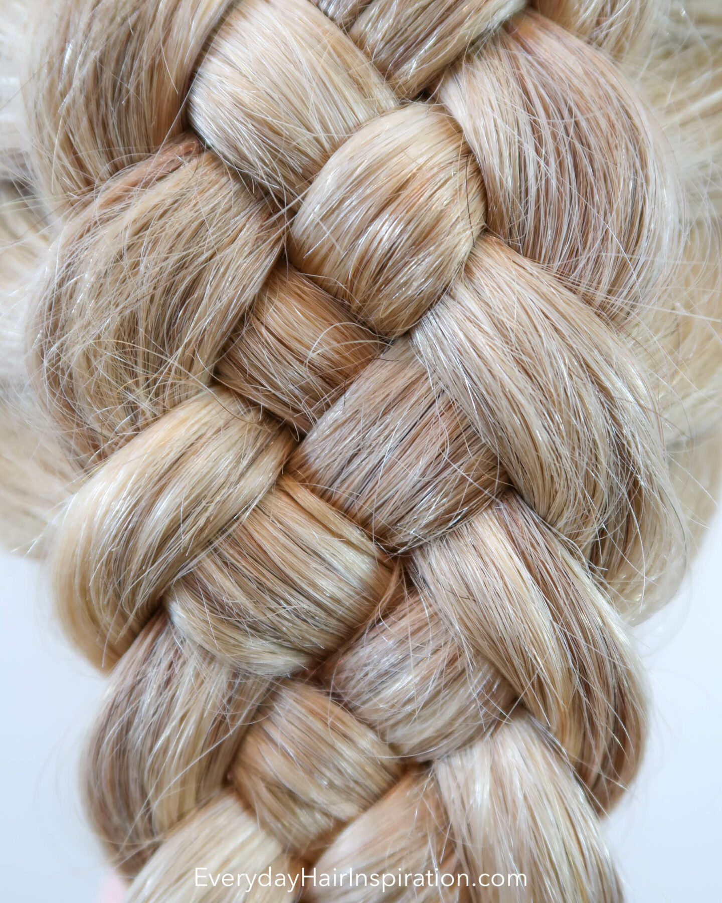 Blonde hairdresser doll with the hair styled into a dutch 5 strand braid, close up of the braid.